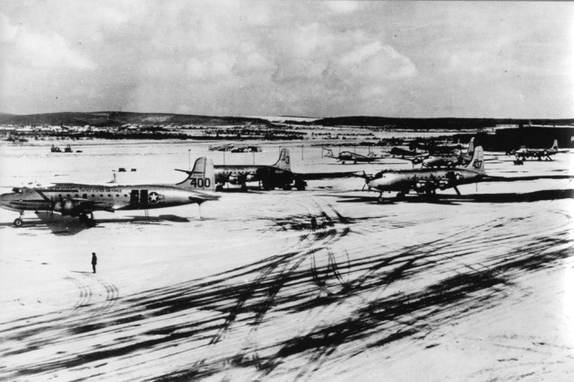 C-54s stand out against the snow at Wiesbaden Air Base during the Berlin Airlift in March 1949.