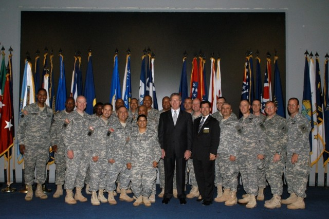 Lee Thompson, executive director, Logistics Civil Augmentation Program, poses for a picture with members of the LOGCAP Support Unit, who recently returned from deployment in support of Operations Enduring Freedom and Iraqi Freedom.