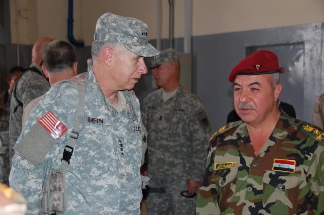 General Benjamin S. Griffin, commanding general, U.S. Army Materiel Command, talks with Brig. Gen. Shallal Abdul Rasool Habeeb, Thursday, May 22, 2008 at Iraq's Taji National Military Depot. U.S. Army photo by Jim Hinnant.