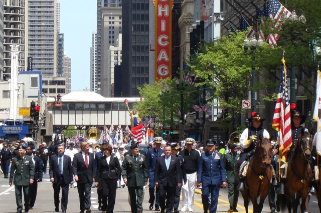 U.S. Army Chief of Staff Gen. George W. Casey Jr. walks with Chicago Mayor Richard M. Daley and other officials during the city of Chicago's Memorial Day parade on Saturday, May 24, 2008.