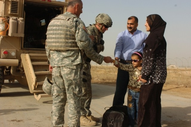 Noor, a young girl receiving eye surgery in the U.S., says goodbye to 1st Lt. Michael Kendrick at Baghdad International Airport, May 26.