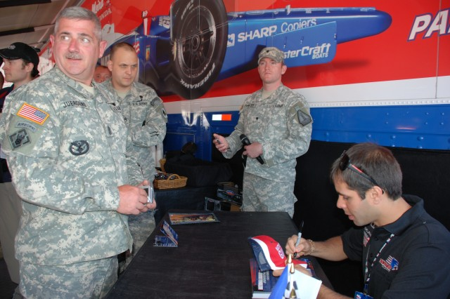 National Guard #4 Driver Vitor Meira signs autographs for Soldiers at last weekend's Indy 500.