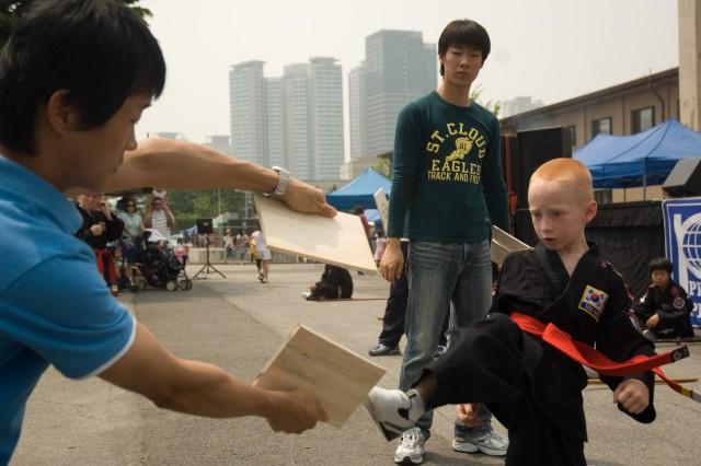 YONGSAN GARRISON, Republic of Korea -- Justine Bridwell shows off his expertise during a youth martial arts demonstration at YongsanAca,!a,,cs block party May 24.