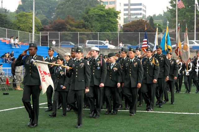 "YONGSAN GARRISON, Republic of Korea Aca,!"" Cadet Devanee Taylor leads her company through the pass and review phase of Seoul American High School Junior Reserve OfficersAca,!a,,c Training Corps awards ceremony May 22."