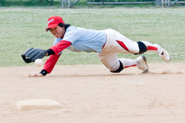 YONGSAN GARRISON, Republic of Korea — Sangji University's Huh mi-jin, second baseman, grabs a grounder during 18th Annual Pacific-wide Softball Tournament championship action Monday. Sangji won the tournament's womens' title for the second consecutive year.