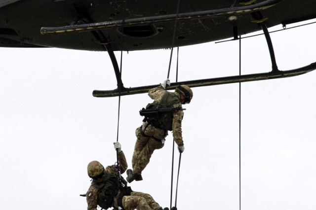 Soldiers from the U.S. and Italian military participate during Combat Life Saver Joint training in Pordenone, Italy. The image was taken Barbara Romano, one of four Army civilians in Europe selected for the Department of Defense's 16th Annual Worldwide Military Photography Workshop.