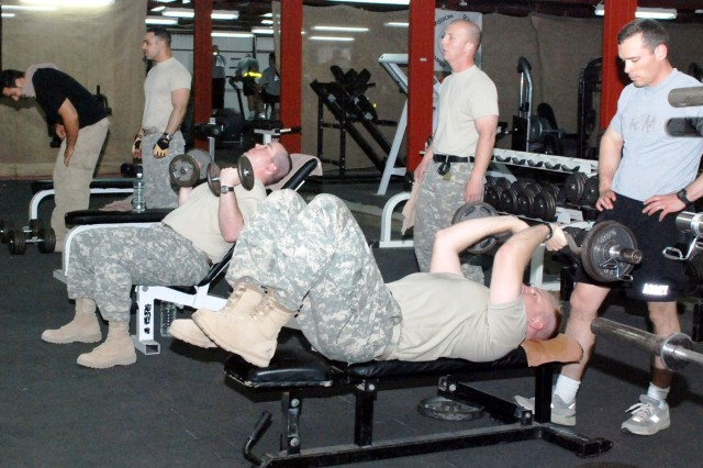"Soldiers lift weights at the Multinational Division Baghdad and 4th Infantry Division gym on Camp Liberty, Iraq, May 21, 2008. <a href=""http://www.defenselink.mil/news/newsarticle.aspx'id=50016""> click for more</a>"