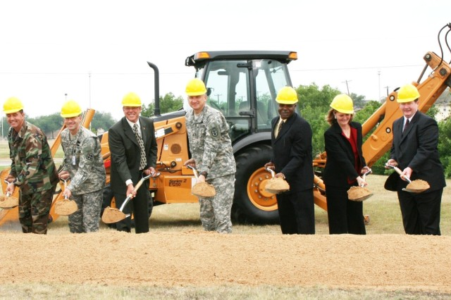 Military and civilian leaders break ground for a telephone core communications switch node facility May 22 at a site on Garden Avenue. The new node will expand telephone and data-switching capabilities by more than 10,000 lines.