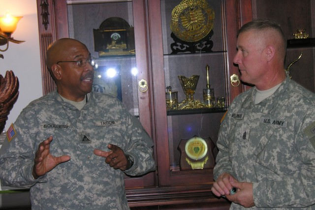 Department of the Army civilian Eric Bogguess, TACOM senior staff technician representative talks with Army Material Command\'s Command Sgt. Maj. Jeffrey Mellinger, Wednesday, May 21, 2008 at Camp Arifjan, Kuwait.