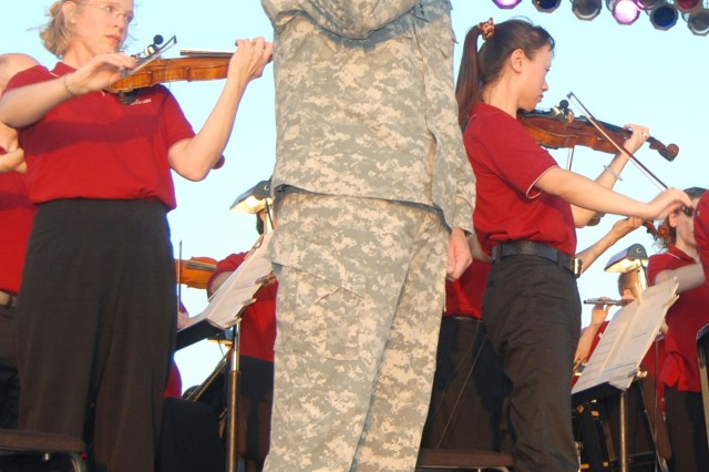Maj. Gen. Russell Czerw, commanding general, Fort Sam Houston and Army Medical Department Center and School, sings the national anthem accompanied by the San Antonio Symphony at the annual Tobin Endowment Concert at MacArthur Field.