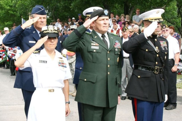 Top military leaders from San Antonio, to include Lt. Gen. Thomas R. Turner II (front row, center), commanding general, U.S. Army North here, salute after a wreath-laying presentation at the base of the U.S. flag.