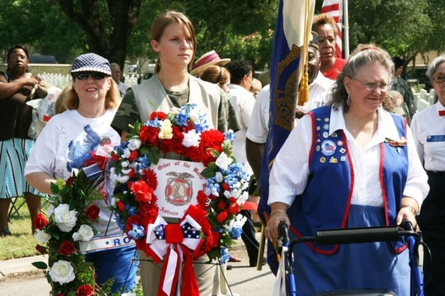Veteran and military organizations participate in a wreath-laying presentation to honor the nation's fallen heroes at Fort Sam Houston National Cemetery.