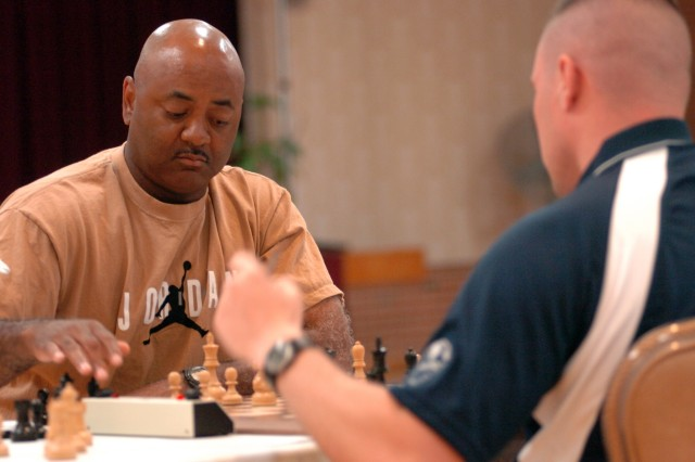 Capt. Chris Pitts of Fort Bliss, Texas, defeats Pvt. David Corona of Fort Lewis, Wash., to finish a career-best third in his ninth appearance in the All-Army Chess Championships May 11-16 at Fort Myer (Va.) Community Center.