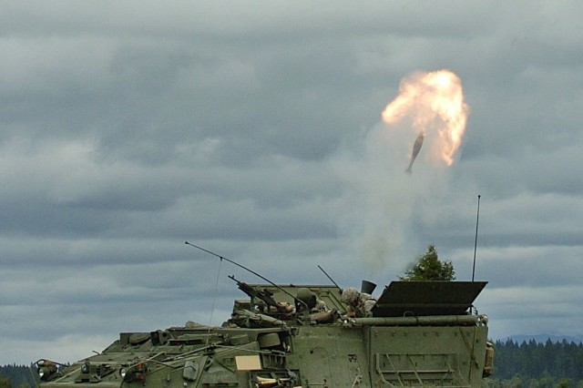 Soldiers from B Troop, 8th Squadron, 1st Cavalry Regiment fire 120mm mortars from their Stryker MCV-B during crew certification.