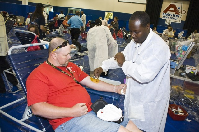 A Red Cross worker preps an Anniston Army Depot employee for blood donation at the May 22 blood drive.