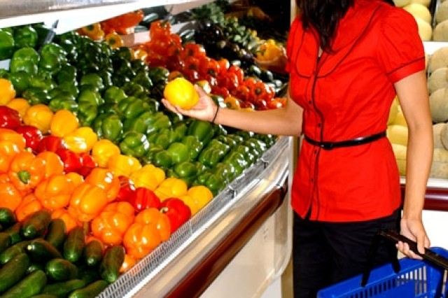 Brittany Romano admires the fruits and vegetables in the new produce section at the Fort Drum commissary.