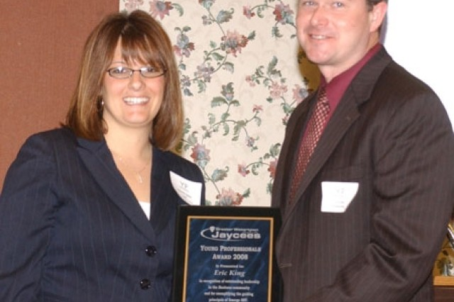 Eric King (right), installation transportation officer, accepts the Young Professionals Business Award from Michelle Capone, president of the Greater Watertown Jaycees.
