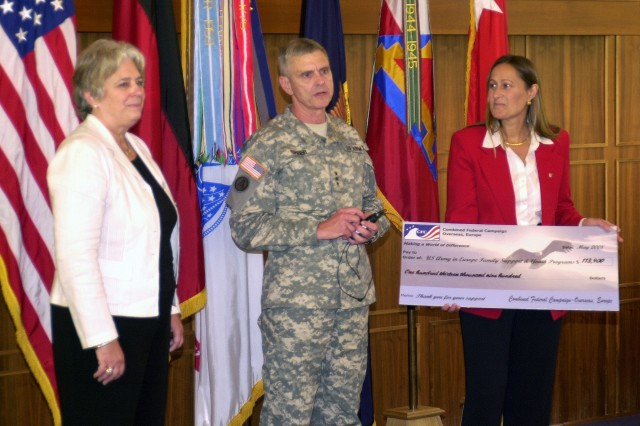 Lt. Gen. Gary D. Speer, acting U.S. Army Europe commanding general, expresses  his thanks for a donation of more than $100,000 presented to Diane Devens, Installation Management Command-Europe regional director (right) by Renee Acosta, chief executive officer of Global Impact, in the USAREUR headquarters May 30. The funds, collected during the 2007 Combined Federal Campaign, will go directly to Army family and youth programs in Europe.