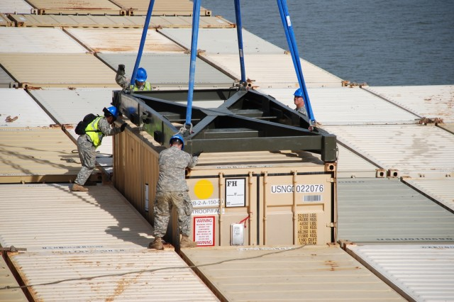 Soldiers from the 149th Transportation Battalion align a cargo container among other containers during Exercise Trident Arch on Naval Weapons Station Yorktown-Cheatham Annex.