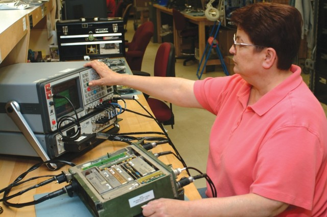 Zandra Kuligowski performs diagnostics testing on a Single Channel Ground and Airborne Radio System at Tobyhanna Army Depot.  Technicians doing similar work at other installations have tested and repaired thousands of the radios to ready them for deploying Soldiers.  Kuligowski is an electronics mechanic.
