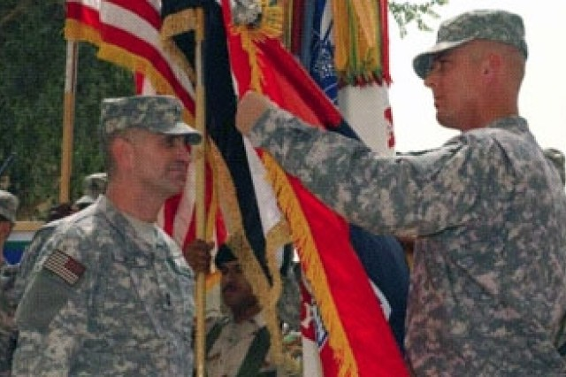 Maj. Gen. Michael Oates, commander, 10th Mountain Division, and Command Sgt. Maj. James Redmore, uncase the division colors during a  Transfer of Authority ceremony June 1 at Multi-National Division Headquarter at Camp Victory. Gen. David Petraeus, commander, Multi-National  Forces Iraq, and Lt. Gen. Lloyd B. Austin III, commander, Multi-National  Corps Iraq, as well as Iraqi government officials and military leaders, were  on hand to witness the ceremony.