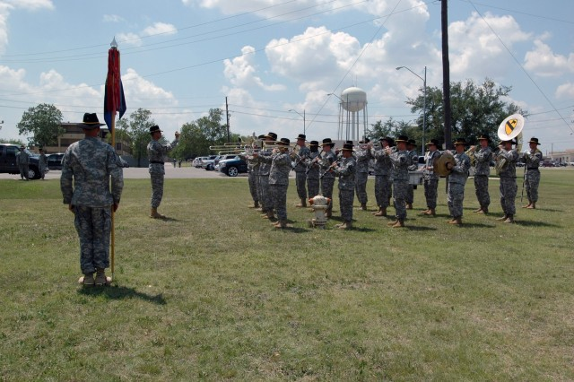 The 1st Cavalry Division band plays as guests begin taking their seats at a change of command ceremony held in front of the division's music hall May 29. During the ceremony, Chief Warrant Officer 4 Glen Nardin relinquished command to Chief Warrant Officer 4 Aaron Graff.