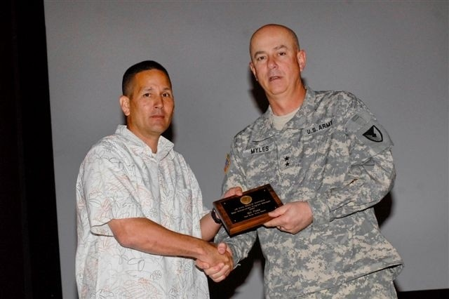 Maj. Gen. James R. Myles, commanding general of the U.S. Army Aviation and Missile Command, presents an award to Bill Pass in recognition as AMC's Best Antiterrorism/Force Protection Program Manager. ""