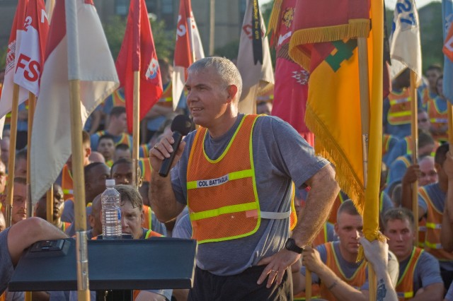 Col. Philip Battaglia, commander, 4th Brigade Combat Team,1st Cavalry Division speaks to his troops after the brigade run May 30 at Fort Hood, Texas. He reiterated that the unit is still set for a 15-month deployment to Iraq and that Soldiers and their families need to prepare themselves for the long deployment that is scheduled to begin in mid-June.