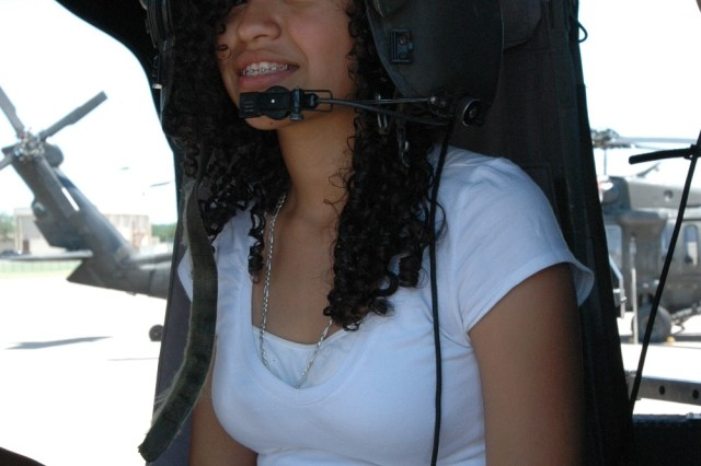 Ninth-grader Angelica Cruz, 14, a cadet with the Molina High School Junior Reserve Officers' Training Corps program in Dallas, sits inside a UH-60 Blackhawk helicopter at the 1st Air Cavalry Brigade, 1st Cavalry Division during a tour of Fort Hood, Texas May 30.