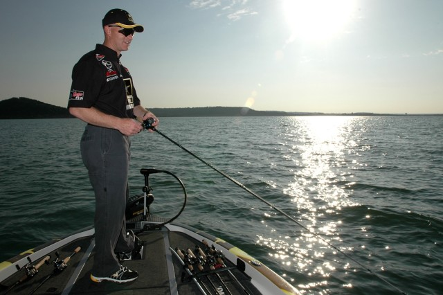 Proctorville, Ohio, native Chief Warrant Officer 4 Carl Fox, an AH-64D Apache attack helicopter senior instructor pilot for Company B, 1st Battalion, 227th Aviation Regiment, 1st Air Cavalry Brigade, 1st Cavalry Division, waits for a bite from a largemouth bass on the deck of his Ranger boat on Stillhouse Lake in Belton, Texas. He wears the Army logo with pride as he represents the Army in his fishing tournaments. Although he isn't a recruiter, he has led his share of people to join the Army's flight program just by being at various events, he said.