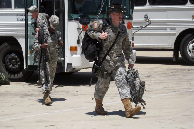On his way to a 15-month deployment to Iraq, Florence, Ore. native Lt. Col. Scott Gerber, executive officer, 4th Brigade Combat Team, 1st Cavalry Division exits a Fort Hood bus at Robert Gray Army Airfield May 31.