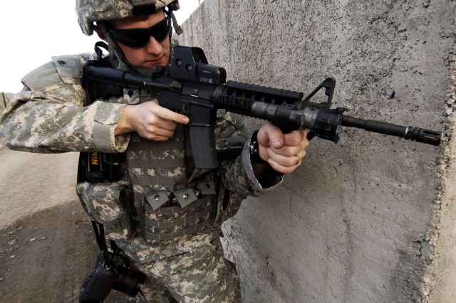 Combat Camera Soldiers like Spc. Derek Nicholson, attached to CJTF-82 in Afghanistan, have to be proficient with the Army\'s weaponry as well as their photographic gear.