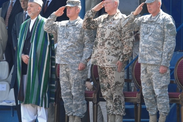 Afghan President Hamid Karzai stands alongside, left to right, U.S. Army Gen. Dan K. McNeill, outgoing NATO International Security Assistance Force Commander; German army Gen. Egon Ramms, commander of NATO's Allied Joint Force Command Brunssum; and U.S. Army Gen. David D. McKiernan, incoming ISAF commander, at the ISAF change-of-command ceremony, June 3.