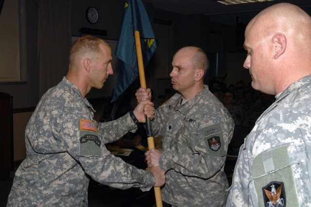 Maj. Mike Russell, left, relinquishes command of the 2nd Space Company to 1st Space Battalion Commander, Lt. Col. Tom James, as Maj. Todd Leitschuh prepares to take charge of the company during an Apr. 7 ceremony at Peterson Air Force Base Building 3.