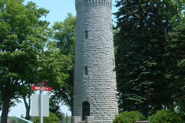 The stone water tower, located in Madison Barracks, was built in 1892 as part of a new water system. The design resembles a medieval fortification tower.