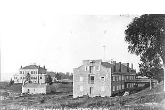 The Stone Hospital, foreground, is one of the historic buildings from Madison Barracks past. When built in 1838, the hospital included revolutionary measures to prevent the spread of disease and encourage healing including large windows that allowed for more sunlight and the circulation of fresh air.