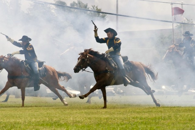 "The 1st Cavalry Division's Horse Detachment charges across Cooper Field at Fort Hood, Texas following the 4th ""Long Knife"" Brigade Combat Team, 1st Cavalry Division color casing ceremony June 4. The Long Knife Brigade is scheduled to deploy to Iraq in mid-June."