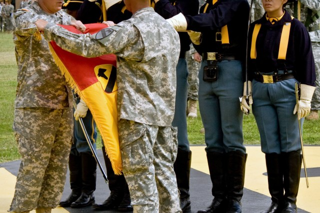 """Col. Philip Battaglia (left) and Command Sgt. Maj. Edwin Rodriguez, the 4th """"Long Knife"""" Brigade Combat Team, 1st Cavalry Division commander and top enlisted leader, case the brigade's colors during a casing ceremony at Fort Hood's Cooper Field June 4. The Long Knife Brigade is scheduled to deploy to Iraq in mid-June."""