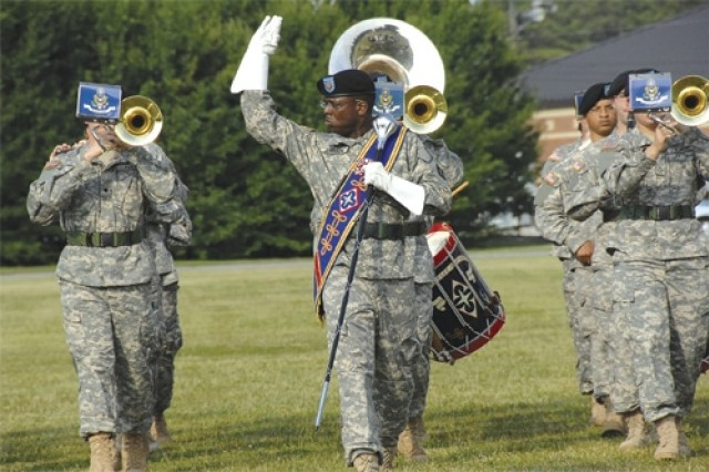 The 392nd Army Band's Sgt. 1st Class Vincent Johnson directs his bandmates during the Combined Arms Support change of command held June 3 at the 23rd Quartermaster Brigade sports field, Fort Lee, Va.