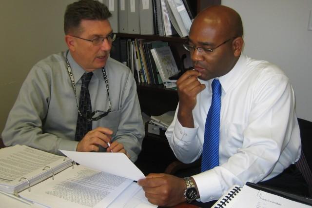 James Mease (left), counsels Europe Region mentee Antonio Jones on developing an individual development plan.  Jones recently transferred to Headquarters IMCOM.