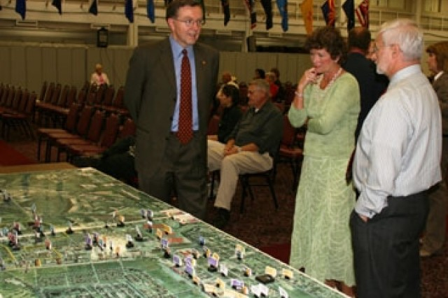 Mike Waldrop (left), deputy to the garrison commander; Jackie Schlatter (center), Base Transformation Office; and Thomas Grippo, from the education center, review construction projects scheduled at Fort Sam Houston under the Base Realignment and Closure at the BRAC Town Hall meeting May 28 at the Army Community Service center.