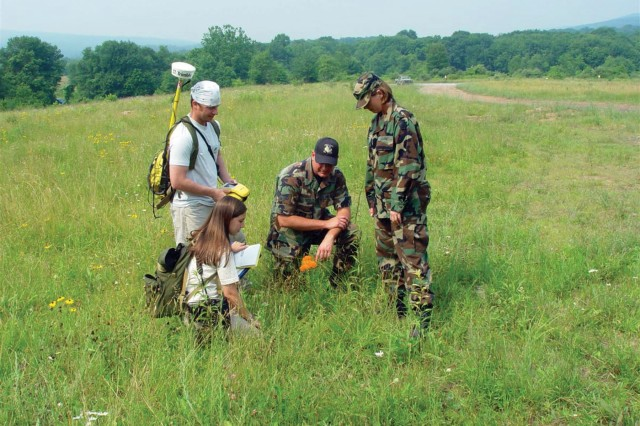 Members of the Fort Indiantown Gap Natural Resources Conservation Team use GPS to record butterfly milkweed, a key nectar plant.