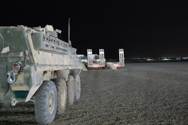 A Stryker Combat Vehicle from 4th Brigade Combat Team, 2nd Infantry Division, awaits transport from Camp Arifjan, Kuwait to a nearby wash rack, June 4, 2008.