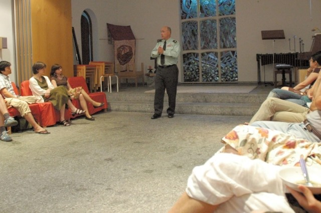 Chaplain (Lt. Col.) David Druckenmiller speaks to a group of international students at Heidelberg University's Okumenisches Institut und Wohnheim fur Studierende Heidelberg, a multi-faith student hall in Heidelberg's Altstadt on May 27. The students had asked Druckenmiller to speak because they were curious about the American presence in Heidelberg.