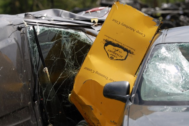 A Camp Atterbury Crier newspaper box is lodged between two destroyed vehicles after a F2 tornado ripped through the installation June 3 at 9:40 p.m. More than 40 buildings and numerous military and civilian vehicles were destroyed during the storm. No injuries were reported as a direct result of the storm.