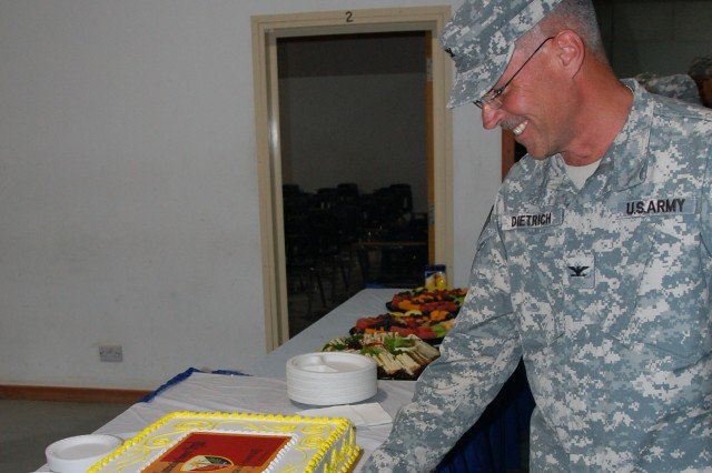 New brigade commander, Col. Shane Dietrich cuts the celebratory cake during a reception following the change of command ceremony for 408th Contracting Support Brigade, June 6, 2008, at Camp Arifjan, Kuwait.