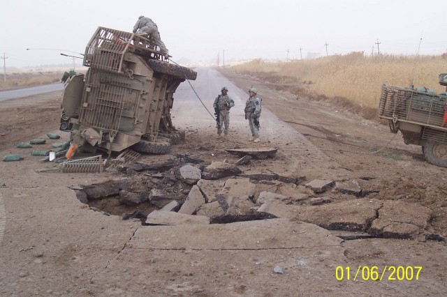 General Lee lies on its side aftrer surviving a buried IED blast in 2007. The Stryker was recovered and protected its Soldiers on more missions until another bomb finally put it out of action.