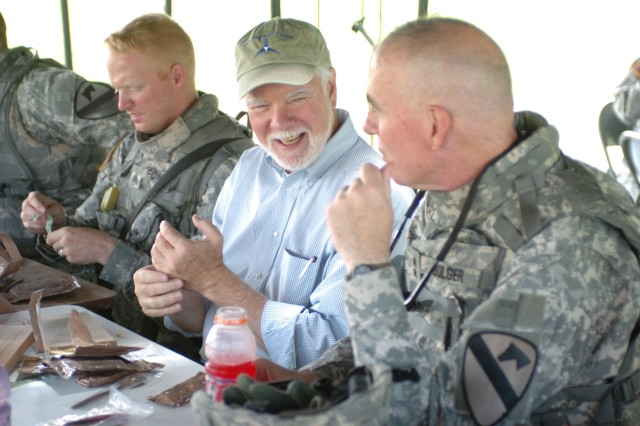 Acting Under Secretary of the Army Nelson Ford enjoys lunch with Soldiers of the 1st Cavalry Division and Maj. Gen. Daniel Bolger (right), 1st Cav. Div. commanding general, after observing Military Operations on Urban Terrain training at Fort Hood, Texas, June 6.