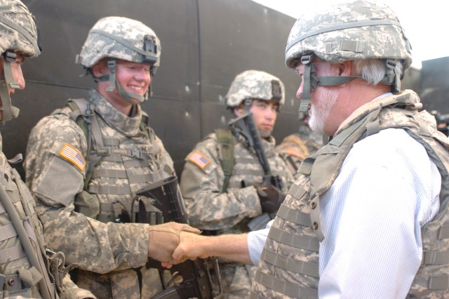 Under Secretary of the Army Nelson Ford coins Soldiers of the 1st Cavalry Division after observing their Military Operations in Urban Terrain training at Fort Hood, Texas, June 6.