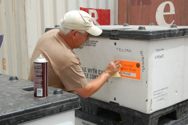 Gene Lyerla, a shipping and receiving manager with ManTech International Corp., prepares a shipment of TROJAN Special Purpose Integrated Remote Intelligence Terminal parts for retrograde to Fort Lewis, Wash., at the U.S. Army Communications-Electronics Command Regional Support Center, Camp Arifjan, Kuwait, June 3, 2008.  Each month the RSC staff returns an estimated 4,000 items to the Army supply system from units in Iraq .